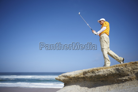 low angle view of golfer standing