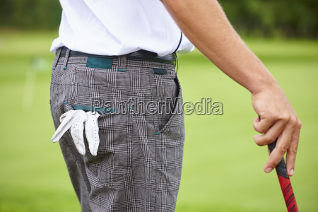 cropped view of golfer holding golf