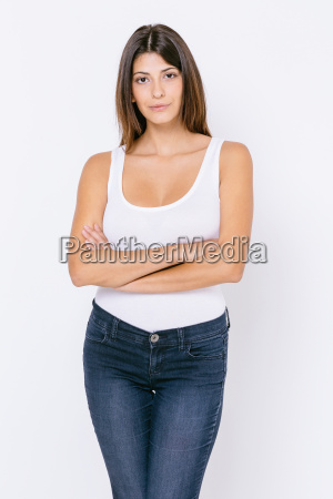 young woman wearing white vest and