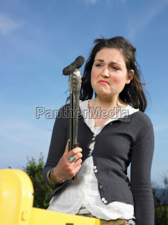 woman looking at burnt sausage