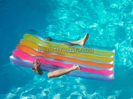 man under pool inflatable