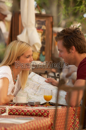 couple laughing in french market cafe