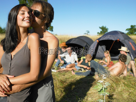 couple kissing backpacking tents