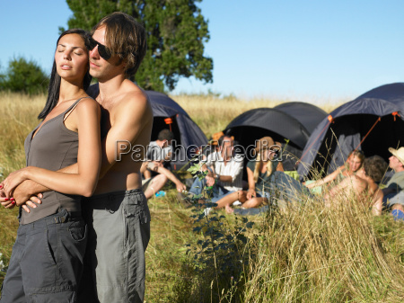 couple at a festival backpacking