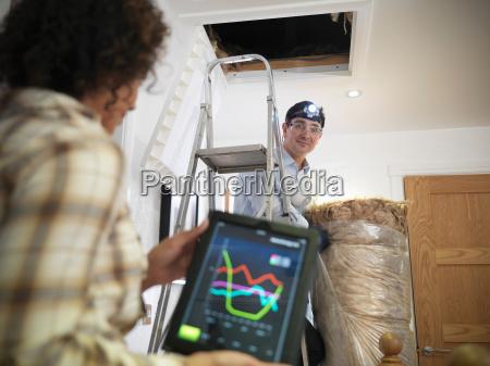 woman checking energy usage on digital