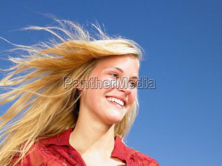 girl smiling wind in her