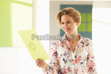 woman looking at green print