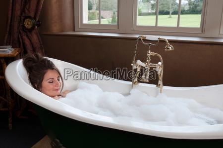 woman relaxing in luxury bath