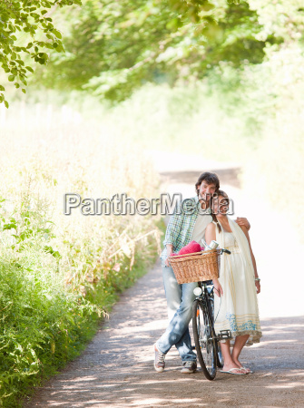 man and woman with bike in