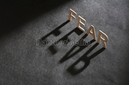 letters spelling fear casting shadow