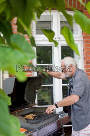 man preparing food for kids