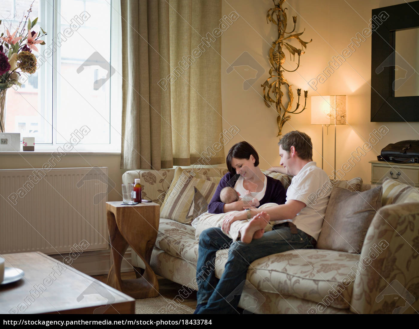 a, couple, and, new, baby, sitting - 18433784