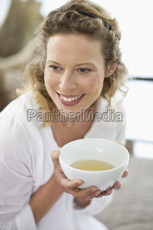 middle aged woman drinking tea