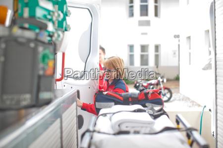 paramedic opening ambulance door