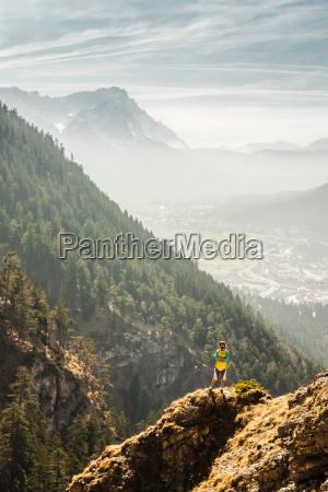man standing on mountain farchant bavaria