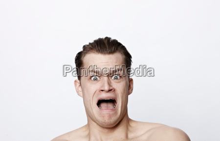 nude man shouting
