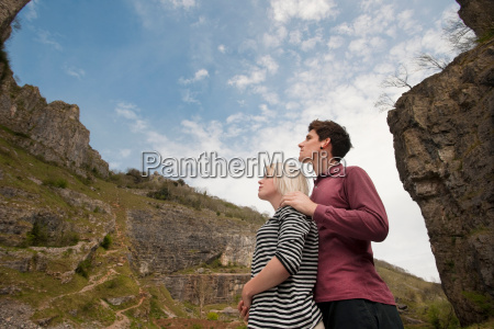 couple looking up in valley