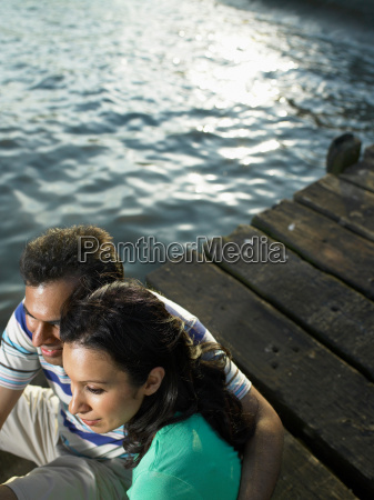 couple sitting on dock together