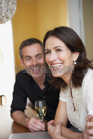 couple sitting on table