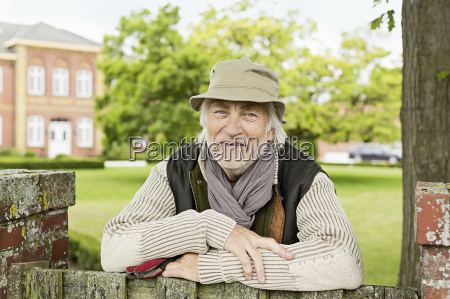 portrait of senior man wearing hat