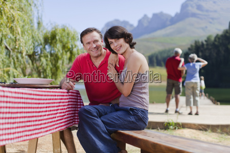 couple sitting at picnic table together