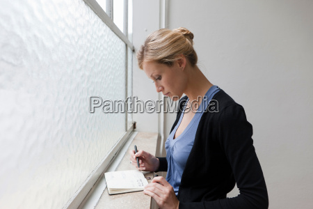 business woman reviewing her schedule