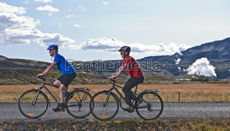 cyclists on road with geo thermal