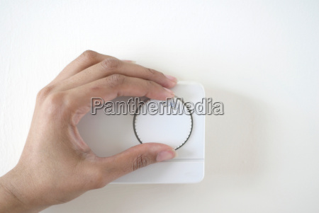 woman adjusting climate control