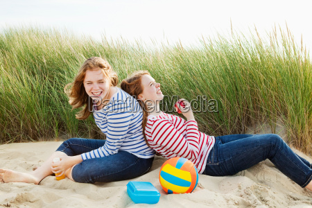 teenagers laughing sitting in dunes