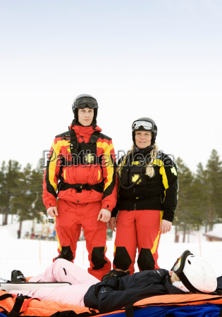 rescue team with skier
