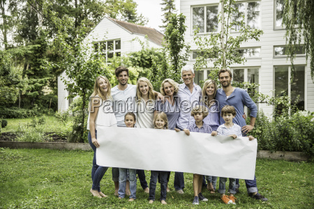 three generational family in garden with