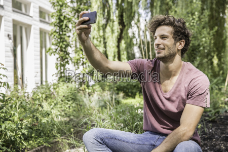 young man taking selfie with cell