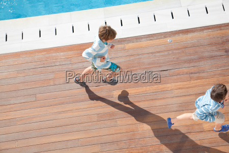 two boys running aerial view