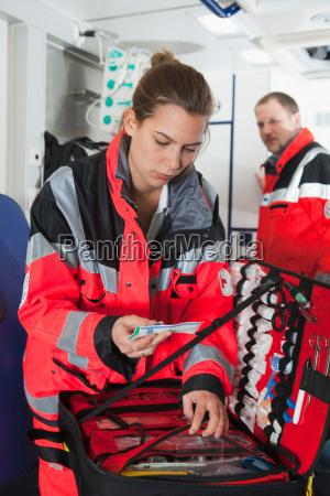 ambulance woman in coach preparing