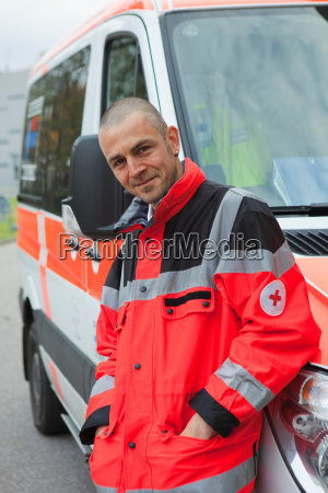 ambulance man in front of coach