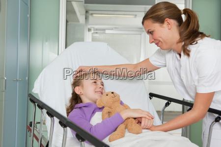nurse caressing ill girl