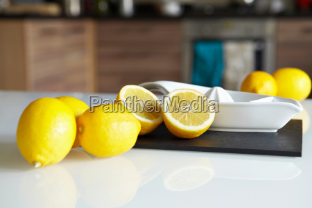 lemons and juicer on kitchen counter
