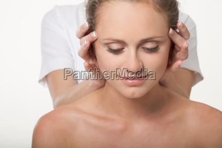 smiling woman having scalp massage