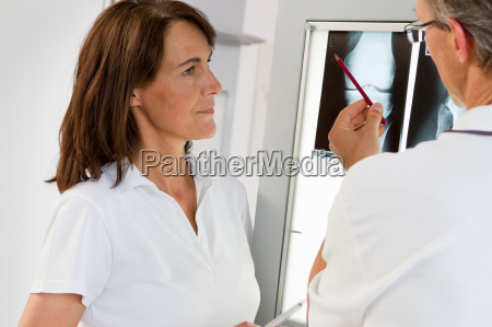 doctor and nurse examining x rays