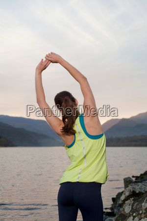 woman standing in front of lake