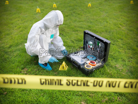 forensic scientist inspecting toolkit at crime
