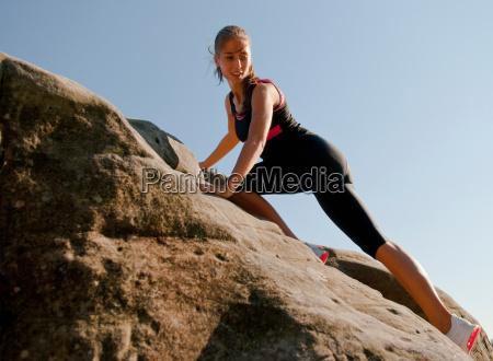 rock climber scaling rock face