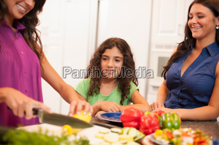sisters cooking together in kitchen