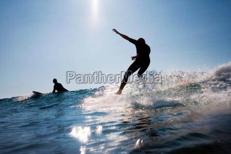 two men surfing