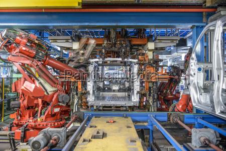 robots welding van body in car