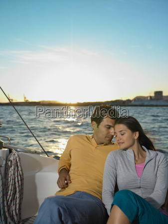 young couple on yacht sitting portrait