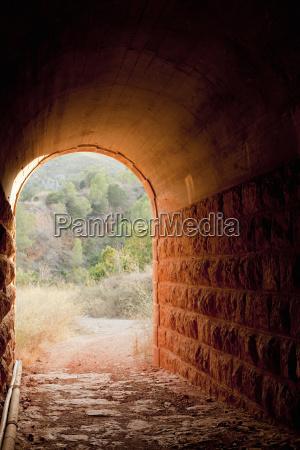 stone tunnel in rural landscape