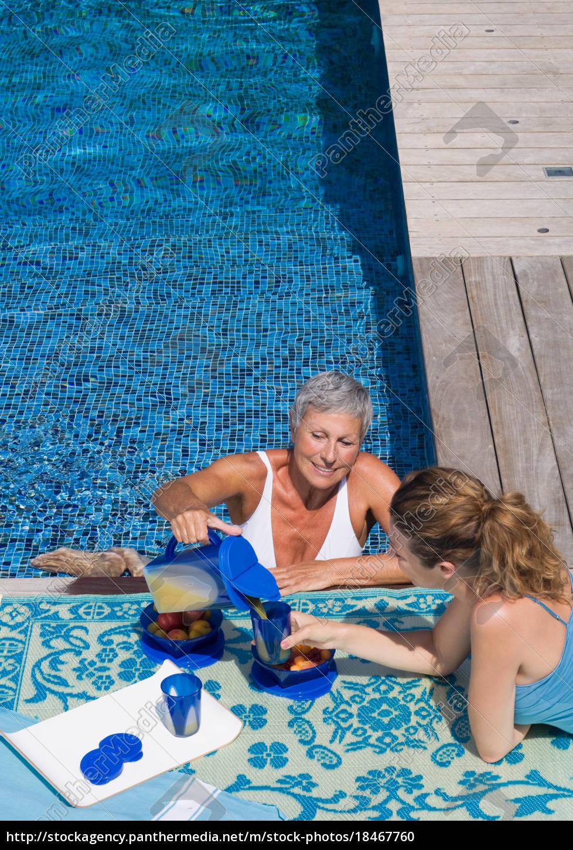 woman, in, swimming, pool, talking, to - 18467760