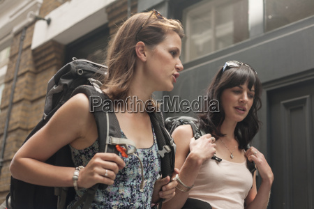 two women backpackers chatting whilst strolling