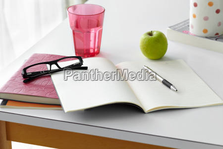 kitchen table still life with notebooks